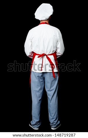 Rear view image of a chef, full length shot. - stock photo