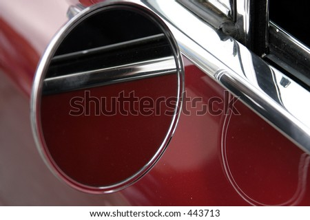 rear view mirror of 67 ford mustang - stock photo