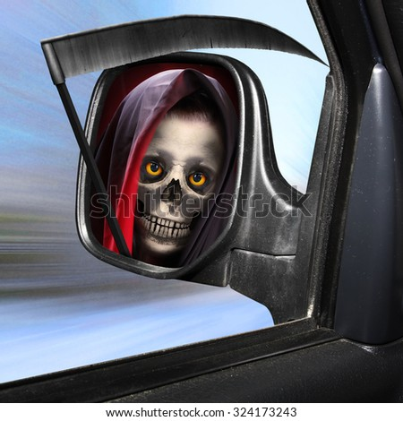 Rear view mirror reflecting Grim Reaper. Road safety theme. - stock photo