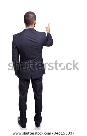 Rear view of a businessman pointing at copy space, isolated on white background - stock photo