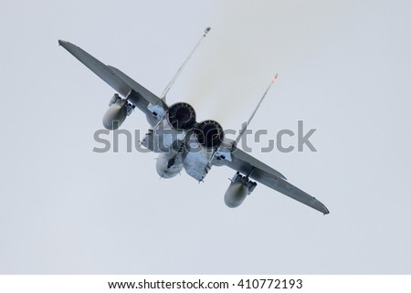 Rear view of a fighter jet take off - stock photo