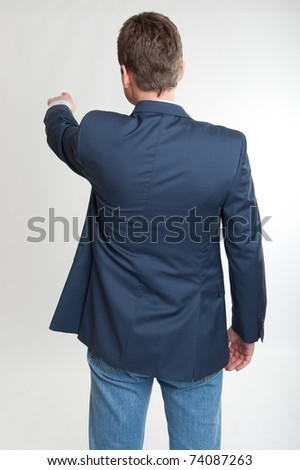 Rear view of a man pointing with his finger - stock photo