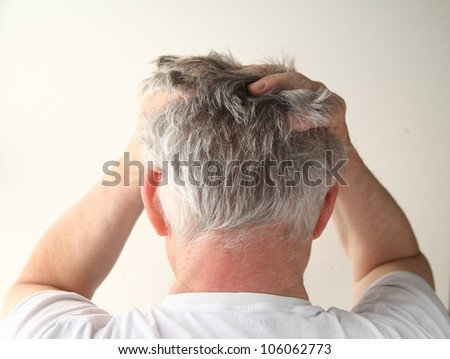 rear view of a man showing negative feelings - stock photo