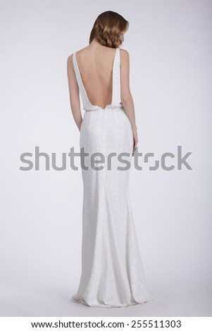 Rear View of a Woman in White Long Dress - stock photo