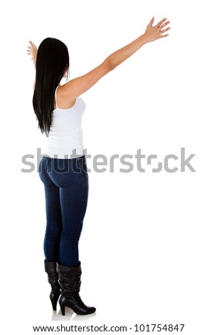 Rear view of a woman with arms open - isolated over white - stock photo