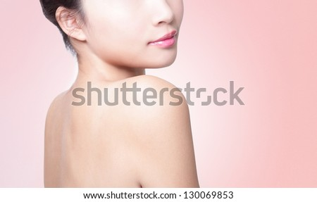 Rear view of a young woman shoulder isolated on pink background, asian beauty - stock photo