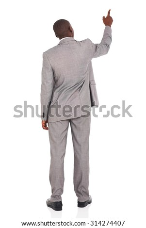rear view of african american businessman pointing at empty space - stock photo