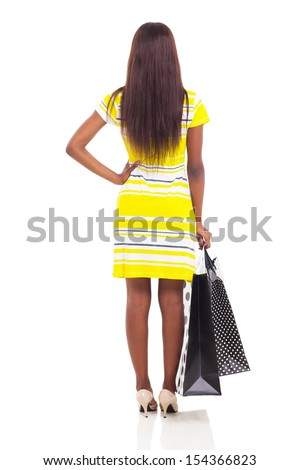 rear view of african woman holding shopping bags isolated on white background - stock photo