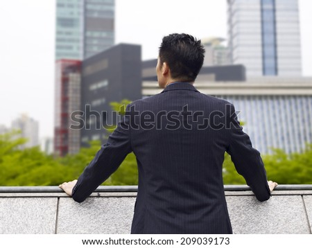 rear view of an asian businessman. - stock photo