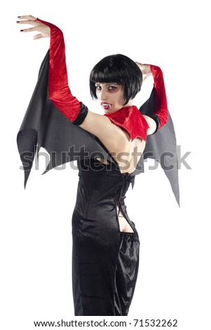 Rear view of an attractive vampire woman. Isolated on pure white background. - stock photo