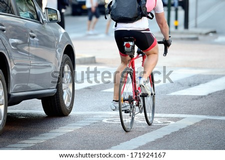Rear view of bicyclist in full gear - stock photo