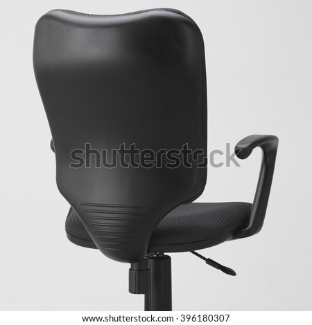 Rear view of black office swivel chair on wheels with a mechanism for adjusting the height. On white background. The back of the chair. - stock photo