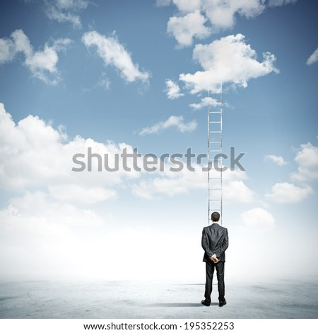 Rear view of businessman standing near ladder going high in sky - stock photo