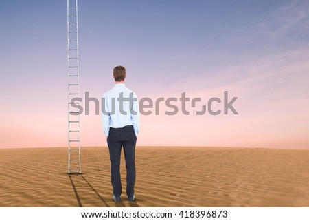 Rear view of businessman with hands in pockets against desert scene - stock photo