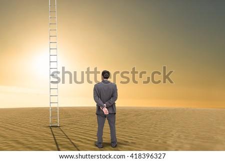 Rear view of classy businessman posing against desert scene - stock photo