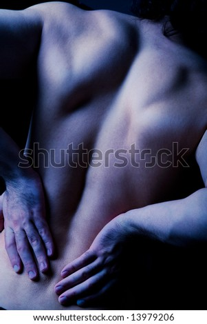 Rear view of diseased male back in a dark blue color - stock photo