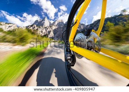 rear view of fast dynamic bicycle outdoor - stock photo
