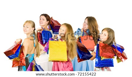 Rear view of girls holding shopping bags - stock photo