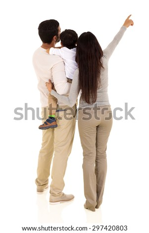 rear view of indian family pointing empty space isolated on white background - stock photo
