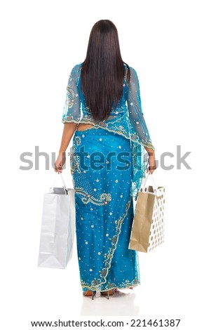 rear view of indian woman holding shopping bags isolated on white background - stock photo