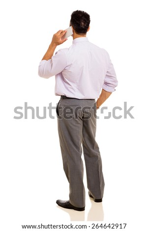 rear view of man talking on cell phone isolated on white background - stock photo
