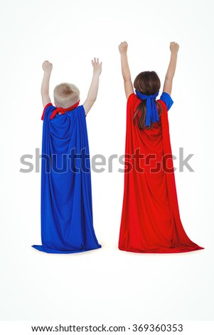 Rear view of masked kids pretending to be superheroes on white screen - stock photo