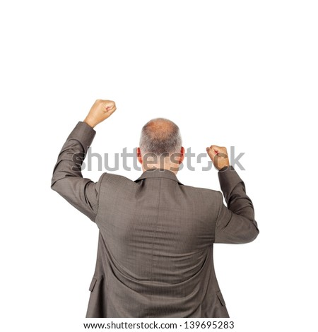 Rear view of mature businessman with arms raised celebrating victory isolated over white background - stock photo