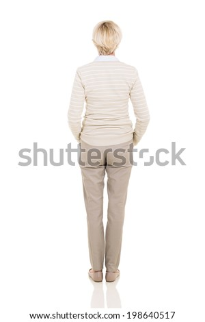rear view of middle aged woman looking up - stock photo