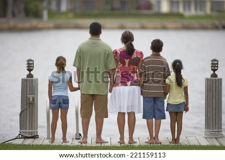 Rear view of multi-ethnic family - stock photo