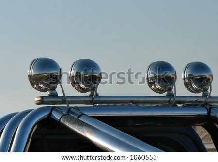 rear view of offroad vehicle night lamps showing nice contrast in repeating reflections - stock photo