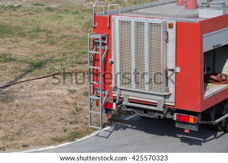 rear view of red fire truck - stock photo
