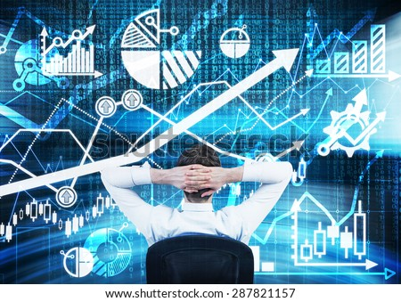 Rear view of sitting financial analyst. A huge digital screen with the range of graphs, charts, and arrow. Forex trading concept. - stock photo