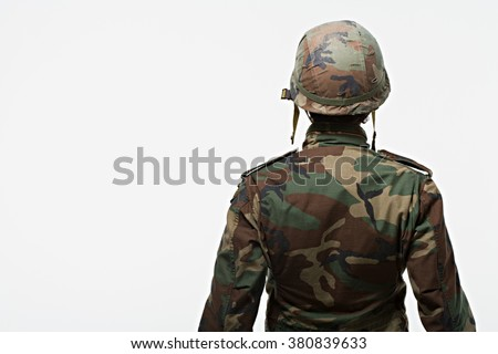 Rear view of soldier - stock photo