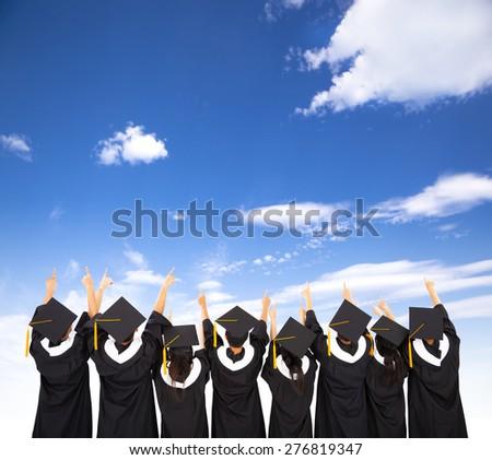 rear view Of  Students Celebrating Graduation  - stock photo