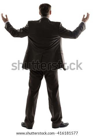 Rear view of successful business man with his arms up isolated white background - stock photo