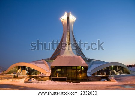 Rear view of the Montreal Olympic Stadium and the world's tallest inclined tower. Taken at dusk in winter. - stock photo