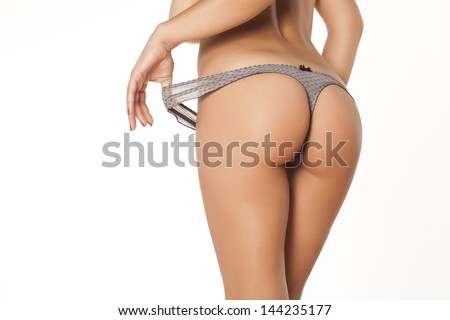 Rear view of the pretty girl buttocks in thong - stock photo