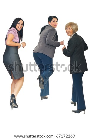 Rear view of three business women running from something or someone  looking back with happy faces isolated on white background - stock photo