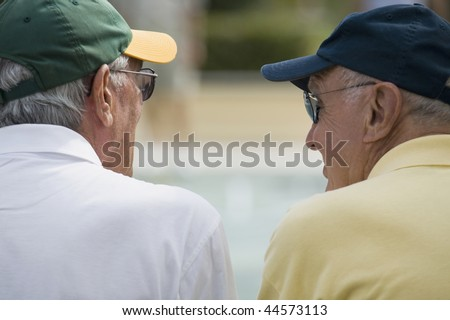 Rear view of two senior men - stock photo