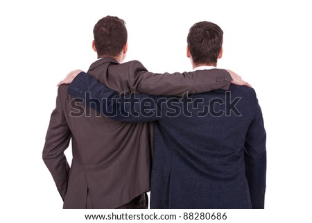 rear view of two young business men friends, over white background - stock photo