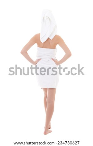 rear view of young beautiful woman wrapped in towel isolated on white background - full length - stock photo