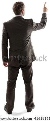 Rear view of young business man pointing at copy space isolated over white background. Full length portrait of businessman standing back - stock photo