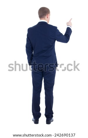 rear view of young business man pointing at something isolated on white background - stock photo