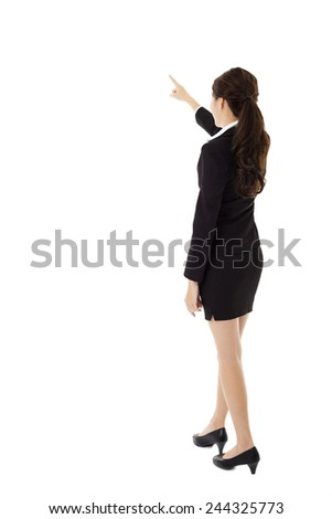 rear view of young business woman pointing - stock photo