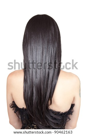 Rear view of young woman with black silky hair, isolated on white background - stock photo