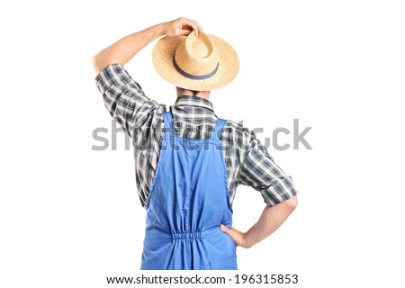 Rear view, studio shot of an agricultural worker isolated on white background - stock photo