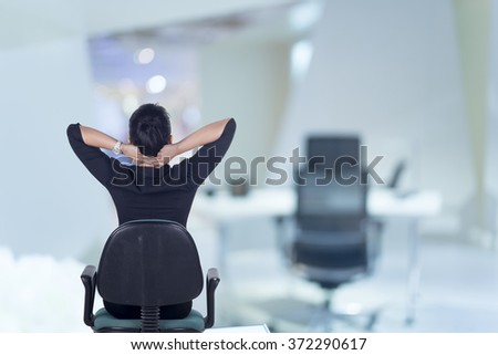Rear View, Thinking business womanม Model is Asian woman. - stock photo