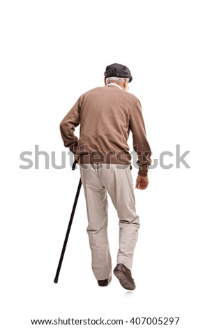 Rear view vertical shot of an old man walking with a black cane isolated on white background - stock photo