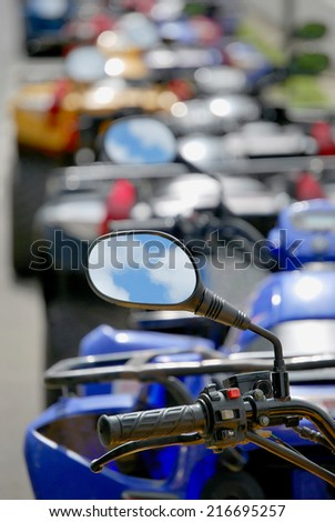 Rearview mirror of a quad. - stock photo