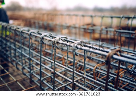 rebar steel bars, reinforcement concrete bars with wire rod used in foundation of construction site. Filtered photo - stock photo